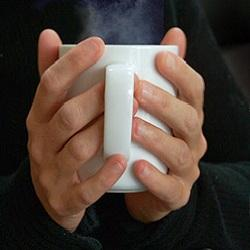 holding cup of coffee1